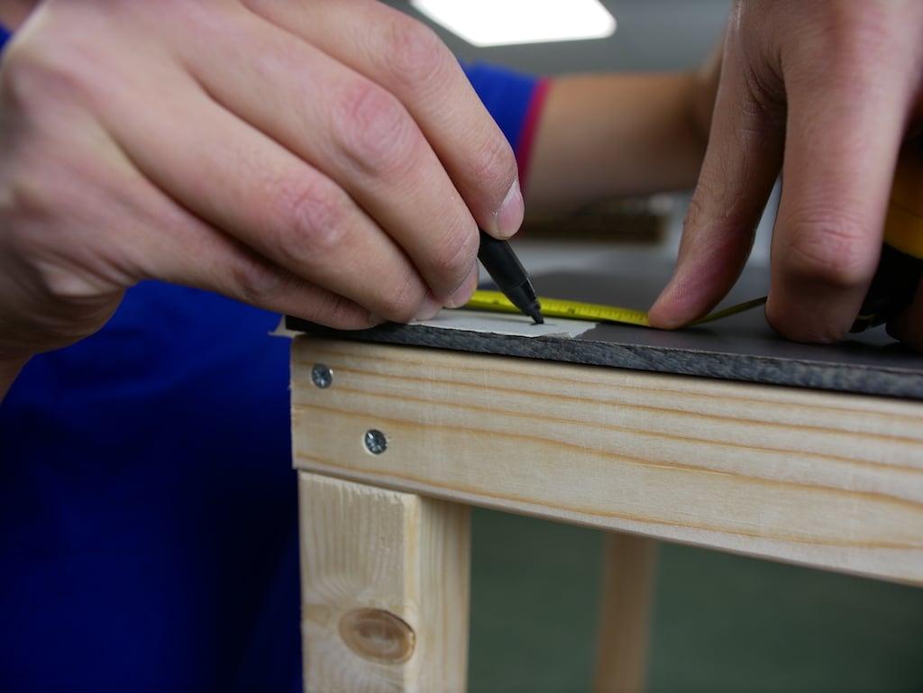 Parcel box marking drill holes hpl