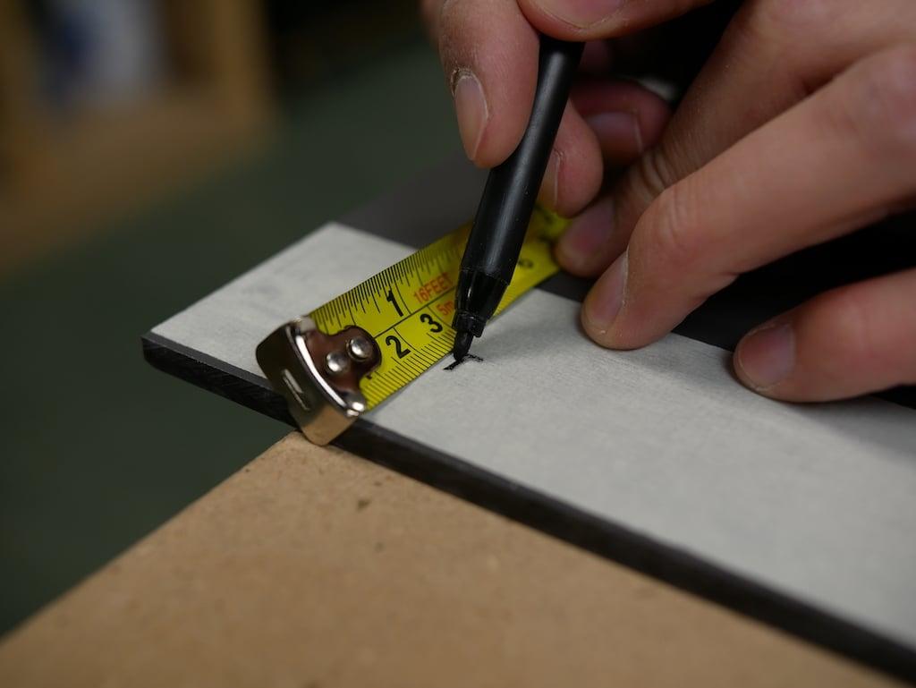 Parcel box marking drill holes