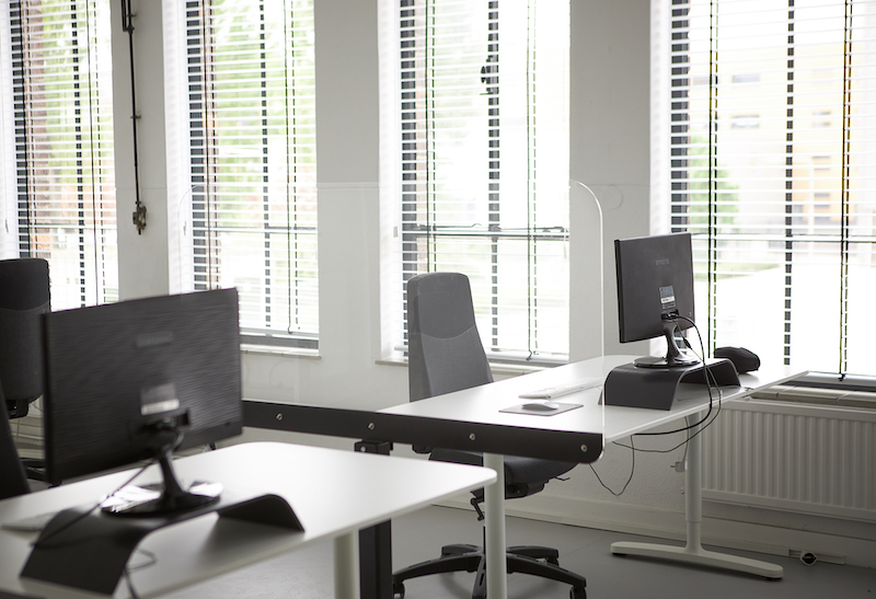 Perspex screen on a base between desks