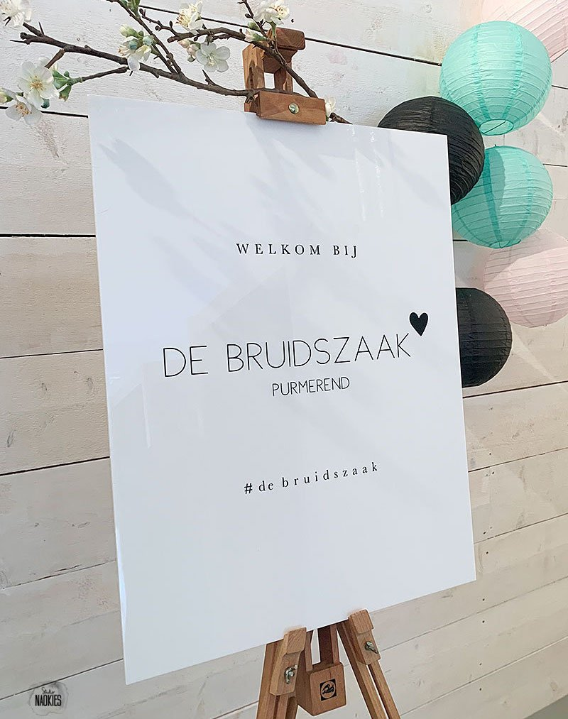 welcome to our wedding sign on an easel