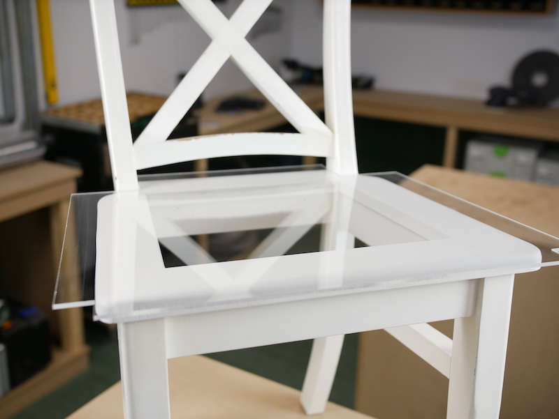 Chair with acrylic sheet