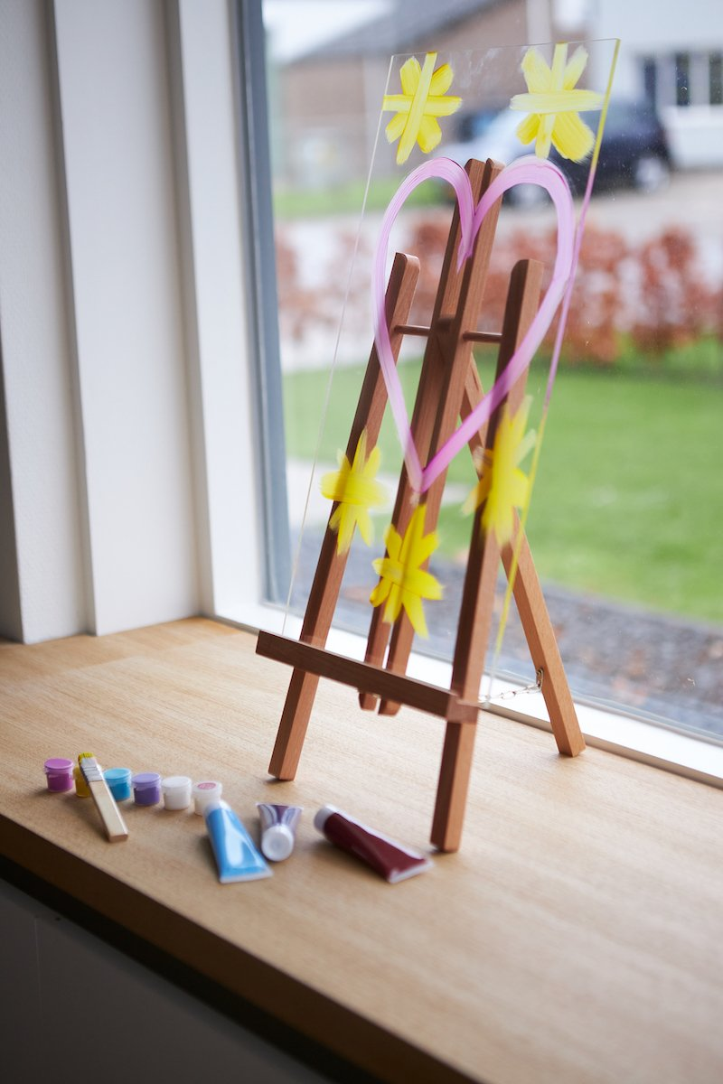 Perspex easel on table